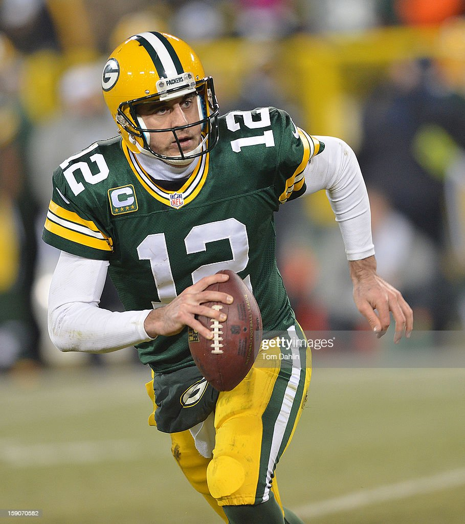 Aaron Rodgers #12 of the Green Bay Packers scrambles during an NFL game against the Minnesota Vikings at Lambeau Field, January 5, 2013 in Green Bay, Wisconsin.