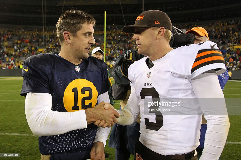 Aaron Rodgers #12 of the Green Bay Packers shakes hands with Brandon Weeden #3 of the Cleveland Browns after the game at Lambeau Field on October 20, 2013 in Green Bay, Wisconsin.