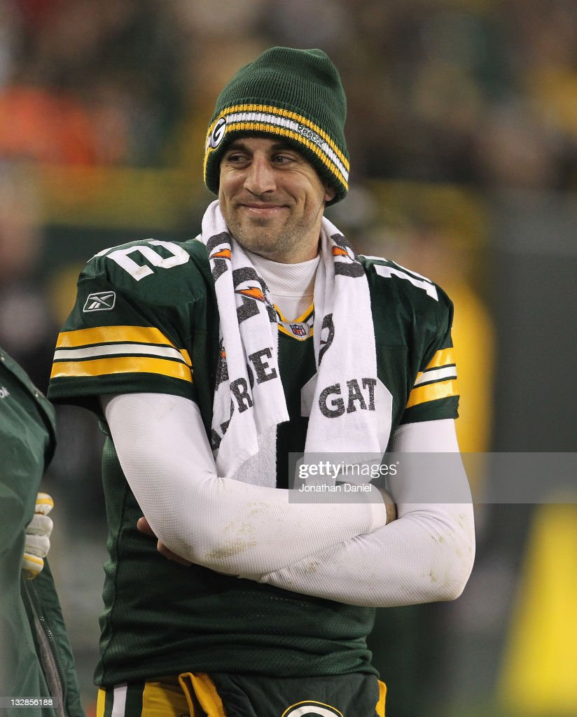 Aaron Rodgers #12 of the Green Bay Packers smiles at a teammate on the sidelines in the 4th quarter against the Minnesota Vikings at Lambeau Field on November 14, 2011 in Green Bay, Wisconsin. The Packers defeated the Vikings 45-7.
