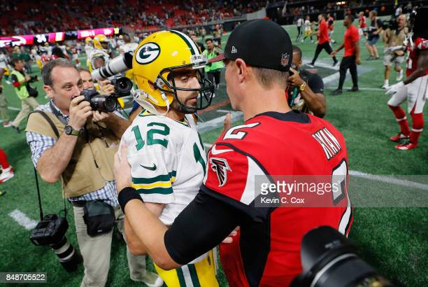 Aaron Rodgers of the Green Bay Packers talks with Matt Ryan of the Atlanta Falcons after the Falcons defeated the Packers 3423 at MercedesBenz...