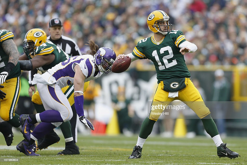 <a gi-track='captionPersonalityLinkClicked' href=/galleries/search?phrase=Aaron+Rodgers+-+Football+americano+-+Quarterback&family=editorial&specificpeople=215257 ng-click='$event.stopPropagation()'>Aaron Rodgers</a> #12 of the Green Bay Packers throws a pass against the Minnesota Vikings at Lambeau Field on December 2, 2012 in Green Bay, Wisconsin. The Packers defeated the Vikings 23-14.