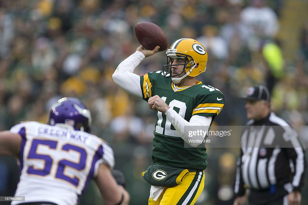 Aaron Rodgers #12 of the Green Bay Packers throws a pass against the Minnesota Vikings at Lambeau Field on December 2, 2012 in Green Bay, Wisconsin. The Packers defeated the Vikings 23-14.