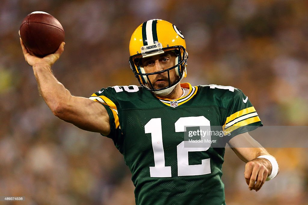 Aaron Rodgers of the Green Bay Packers throws a pass in the first quarter against the Seattle Seahawks during their game at Lambeau Field on...