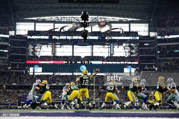 Aaron Rodgers of the Green Bay Packers throws a pass in the first half during the NFC Divisional Playoff Game against the Dallas Cowboys at ATT...