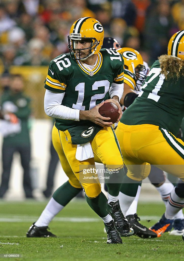 <a gi-track='captionPersonalityLinkClicked' href=/galleries/search?phrase=Aaron+Rodgers+-+American+Football+Quarterback&family=editorial&specificpeople=215257 ng-click='$event.stopPropagation()'>Aaron Rodgers</a> #12 of the Green Bay Packers turns to hand off against the Chicago Bears at Lambeau Field on November 4, 2013 in Green Bay, Wisconsin. The Bears defeated the Packers 27-20.