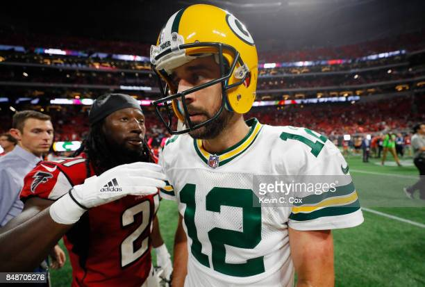 Aaron Rodgers of the Green Bay Packers walks off the field after being defeated by the Atlanta Falcons 3423 at MercedesBenz Stadium on September 17...