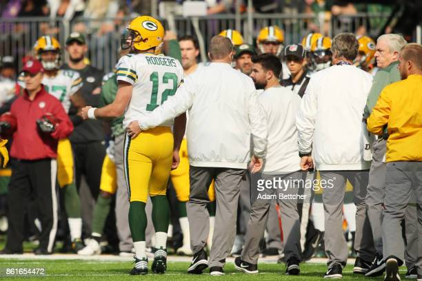 Aaron Rodgers of the Green Bay Packers walks off the field after being injured during the first quarter of the game against the Minnesota Vikings on...