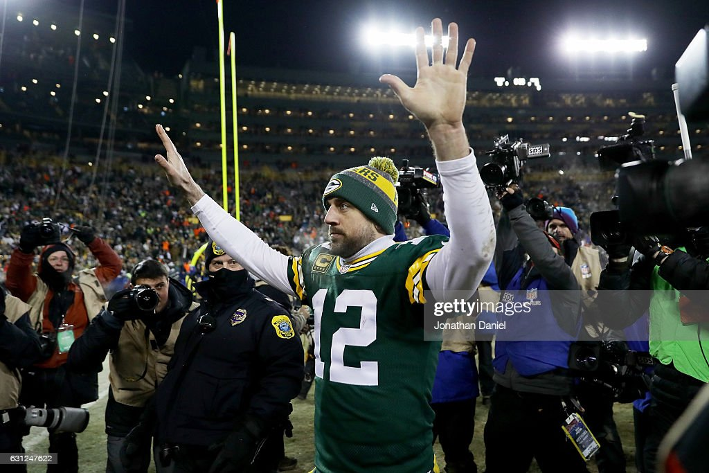 Aaron Rodgers #12 of the Green Bay Packers walks off the field after beating the New York Giants 38-13 in the NFC Wild Card game at Lambeau Field on January 8, 2017 in Green Bay, Wisconsin.