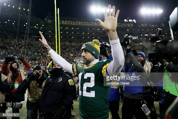 Aaron Rodgers of the Green Bay Packers walks off the field after beating the New York Giants 3813 in the NFC Wild Card game at Lambeau Field on...