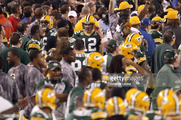 Aaron Rodgers of the Green Bay Packers walks to the sideline after an 8 yard touchdown pass in the fourth quarter against the Pittsburgh Steelers...