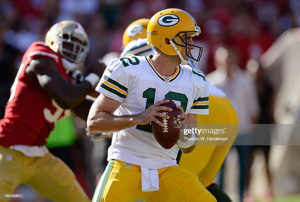 Aaron Rogers #12 of the Green Bay Packers drops back to pass against the San Francisco 49ers during the fourth quarter at Candlestick Park on September 8, 2013 in San Francisco, California.