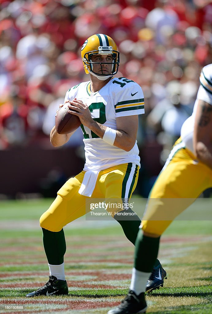 Aaron Rogers #12 of the Green Bay Packers drops back to pass against the San Francisco 49ers during the second quarter at Candlestick Park on September 8, 2013 in San Francisco, California.