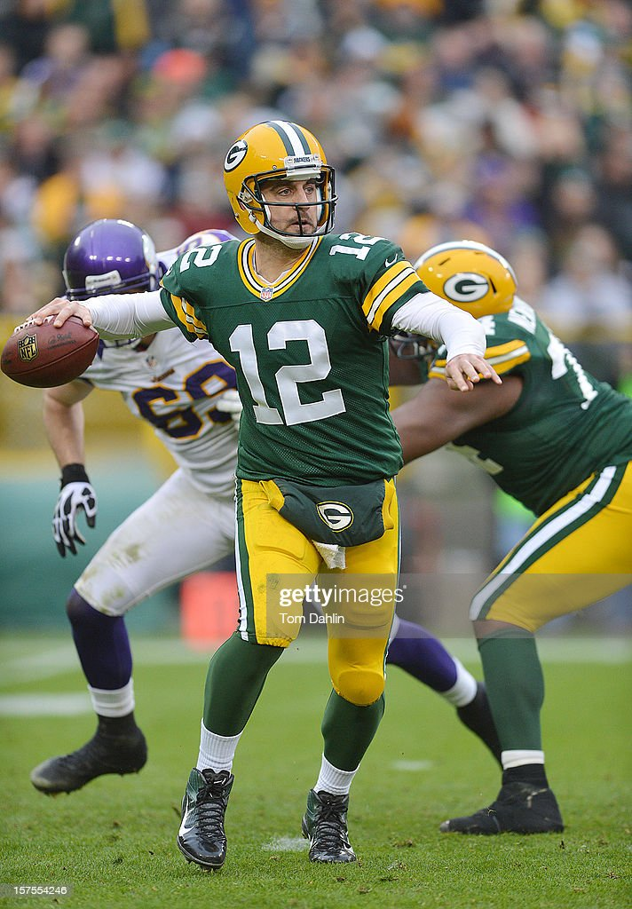 Aaron Rogers #12 of the Green Bay Packers scrambles during an NFL game against the Minnesota Vikings at Lambeau Field on December 2, 2012 in Green Bay, Wisconsin.