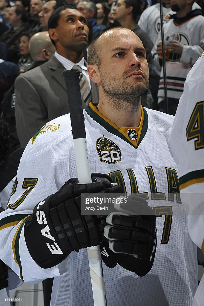 <a gi-track='captionPersonalityLinkClicked' href=/galleries/search?phrase=Aaron+Rome&family=editorial&specificpeople=2139287 ng-click='$event.stopPropagation()'>Aaron Rome</a> #27 of the Dallas Stars stands for the singing of the national anthem prior to a game against the Edmonton Oilers on February 6, 2013 at Rexall Place in Edmonton, Alberta, Canada.