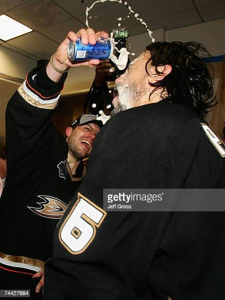 Aaron Rome sprays George Parros of the Anaheim Ducks with beer in the locker room after defeating the Ottawa Senators in Game Five of the 2007...
