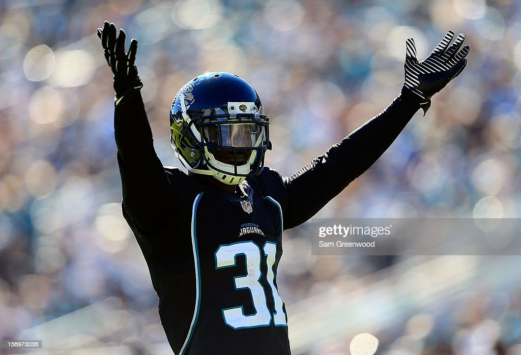 Aaron Ross #31 of the Jacksonville Jaguars raises his arms during the game against the Tennessee Titans at EverBank Field on November 25, 2012 in Jacksonville, Florida.