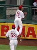 Aaron Rowand of the Philadelphia Phillies makes a leaping catch and crashes into the outfield wall during the game against the New York Mets at...