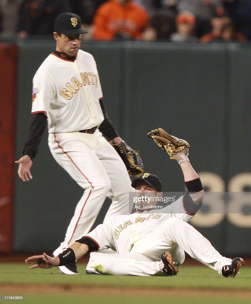 <a gi-track='captionPersonalityLinkClicked' href=/galleries/search?phrase=Aaron+Rowand&family=editorial&specificpeople=210740 ng-click='$event.stopPropagation()'>Aaron Rowand</a> #33 of the San Francisco Giants catches a ball hit by Jon Jay of the St. Louis Cardinals in the seventh inning at AT&T Park on April 9, 2011 in San Francisco, California.