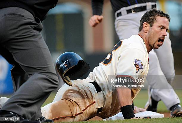 Aaron Rowand of the San Francisco Giants is safe at third going from first to third on a base hit to right field by Miguel Tejada against the New...