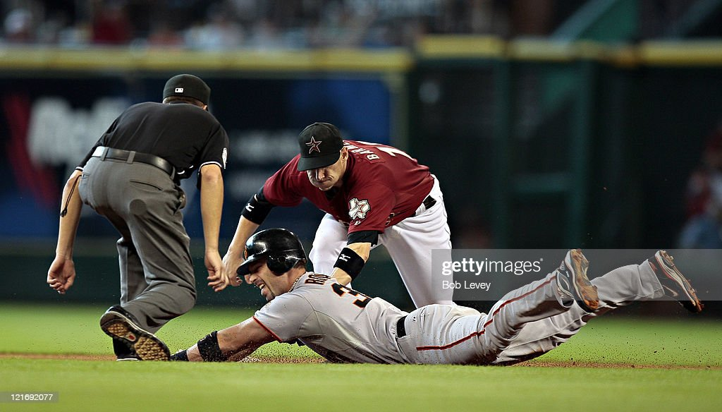 <a gi-track='captionPersonalityLinkClicked' href=/galleries/search?phrase=Aaron+Rowand&family=editorial&specificpeople=210740 ng-click='$event.stopPropagation()'>Aaron Rowand</a> #33 of the San Frnacisco Giants is tagged out by shortstop <a gi-track='captionPersonalityLinkClicked' href=/galleries/search?phrase=Clint+Barmes&family=editorial&specificpeople=208223 ng-click='$event.stopPropagation()'>Clint Barmes</a> #12 as second base umpire Cory Blaser looks in at Minute Maid Park on August 21, 2011 in Houston, Texas.