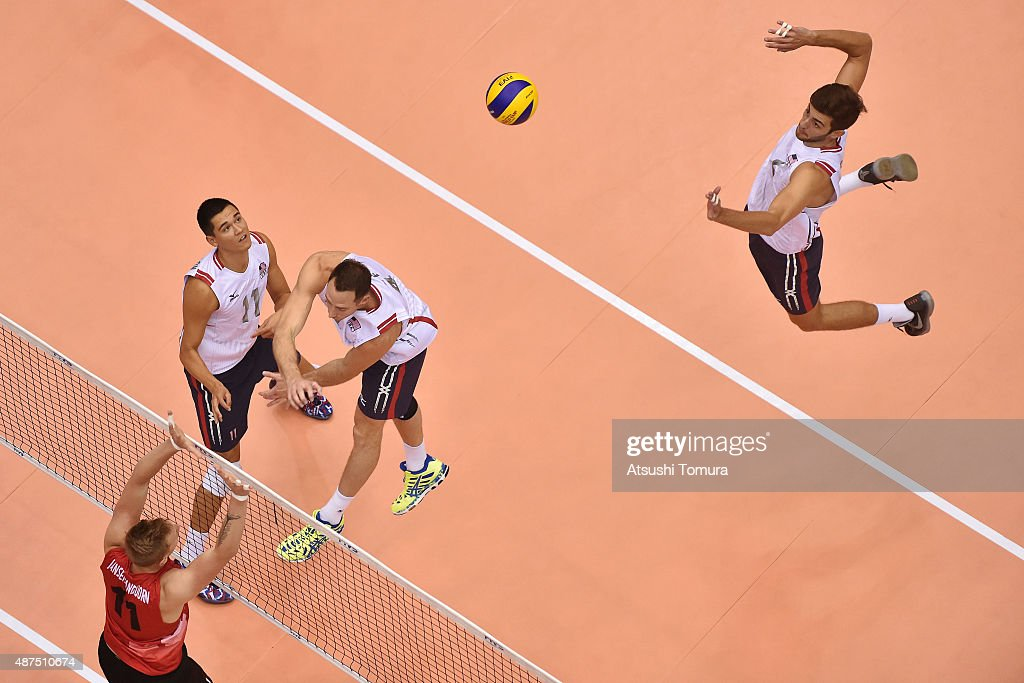 <a gi-track='captionPersonalityLinkClicked' href=/galleries/search?phrase=Aaron+Russell+-+Volleyball+Player&family=editorial&specificpeople=15920615 ng-click='$event.stopPropagation()'>Aaron Russell</a> of the USA spikes in the match between Canada and USA during the FIVB Men's Volleyball World Cup Japan 2015 at the Hiroshima Green Arena on September 10, 2015 in Hiroshima, Japan.