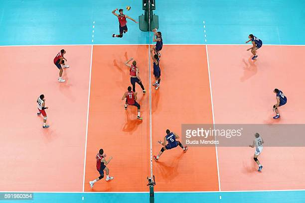Aaron Russell of United States spikes the ball against Italy during the Men's Volleyball Semifinal match on Day 14 of the Rio 2016 Olympic Games at...