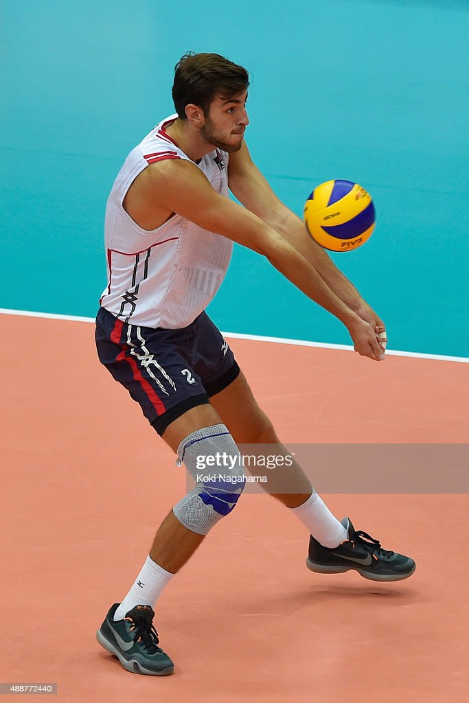 <a gi-track='captionPersonalityLinkClicked' href=/galleries/search?phrase=Aaron+Russell+-+Volleyball+Player&family=editorial&specificpeople=15920615 ng-click='$event.stopPropagation()'>Aaron Russell</a> of USA receives the ball in the match against Iran during the FIVB Men's Volleyball World Cup Japan 2015 at the Osaka Municipal Central Gymnasium on September 17, 2015 in Osaka, Japan.
