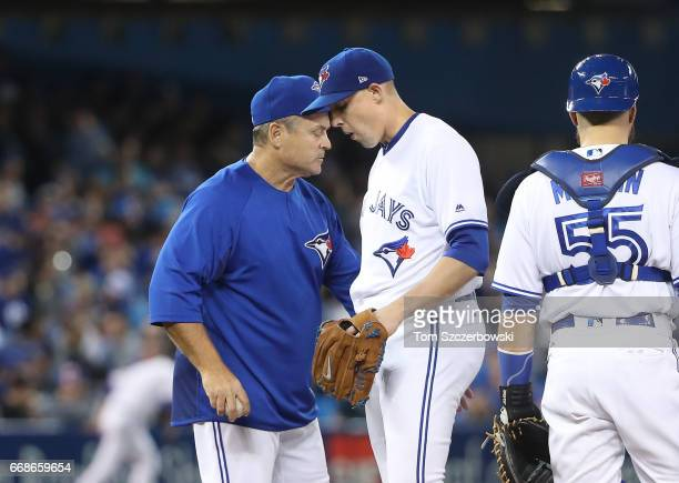 Aaron Sanchez of the Toronto Blue Jays exits the game as he is relieved by manager John Gibbons in the sixth inning during MLB game action against...