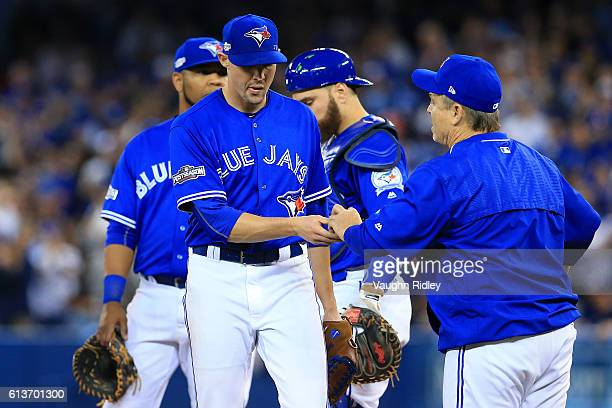 Aaron Sanchez of the Toronto Blue Jays is relieved from the game by manager John Gibbons in the sixth inning against the Texas Rangers during game...