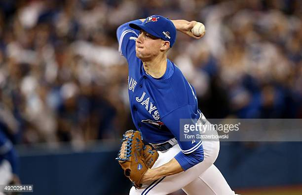 Aaron Sanchez of the Toronto Blue Jays pitches in the 12th inning against the Texas Rangers during game two of the American League Division Series at...