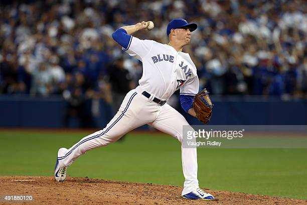 Aaron Sanchez of the Toronto Blue Jays throws a pitch in the ninth inning against the Texas Rangers during game one of the American League Division...