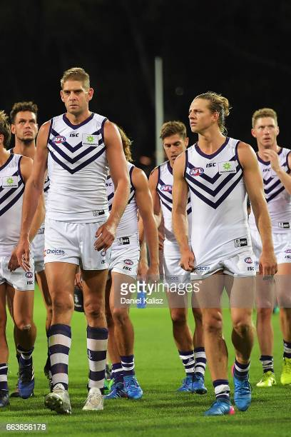 Aaron Sandilands and Nat Fyfe of the Dockers walk from the field after the round two AFL match between the Port Adelaide Power and the Fremantle...