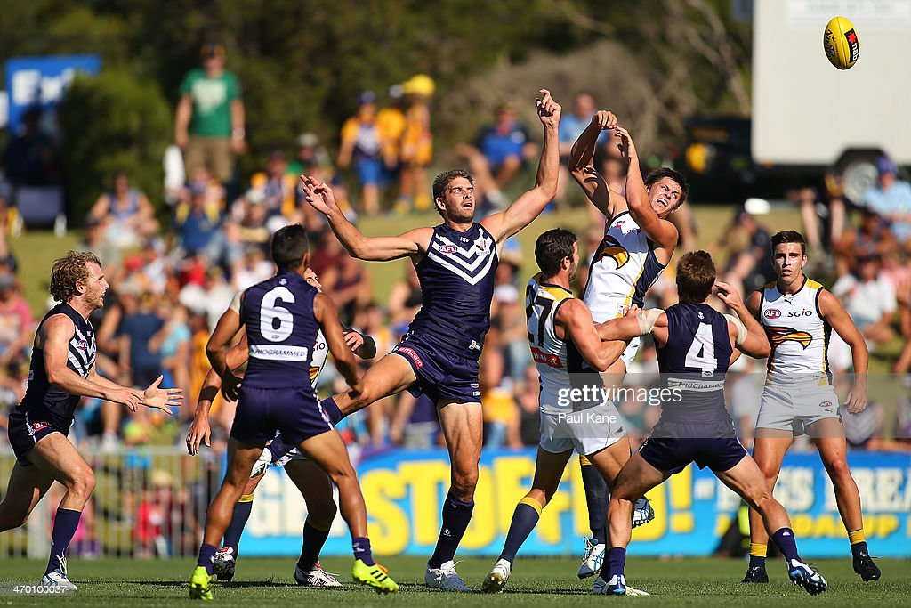 Aaron Sandilands of the Dockers and Callum Sinclair of the Eagles contest the ruck during the round two NAB Challenge Cup AFL match between the Fremantle Dockers and the West Coast Eagles at Arena Joondalup on February 18, 2014 in Perth, Australia.