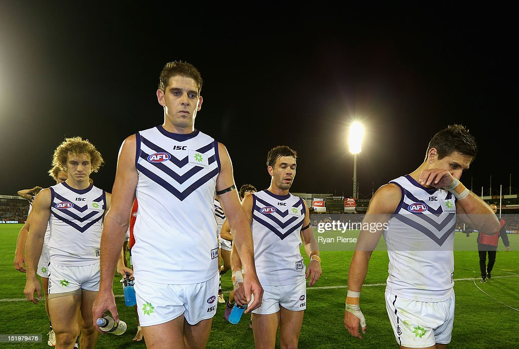 <a gi-track='captionPersonalityLinkClicked' href=/galleries/search?phrase=Aaron+Sandilands&family=editorial&specificpeople=171132 ng-click='$event.stopPropagation()'>Aaron Sandilands</a> of the Dockers and <a gi-track='captionPersonalityLinkClicked' href=/galleries/search?phrase=Matthew+Pavlich&family=editorial&specificpeople=208649 ng-click='$event.stopPropagation()'>Matthew Pavlich</a> of the Dockers look dejected as they lead their team from the ground after the AFL Second Semi Final match between the Adelaide Crows and the Fremantle Dockers at AAMI Stadium on September 14, 2012 in Adelaide, Australia.