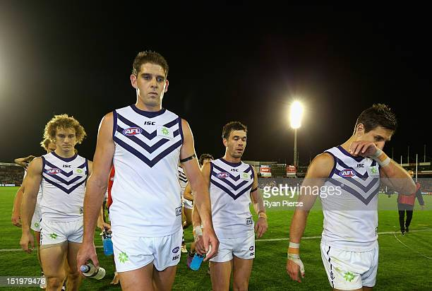 Aaron Sandilands of the Dockers and Matthew Pavlich of the Dockers look dejected as they lead their team from the ground after the AFL Second Semi...