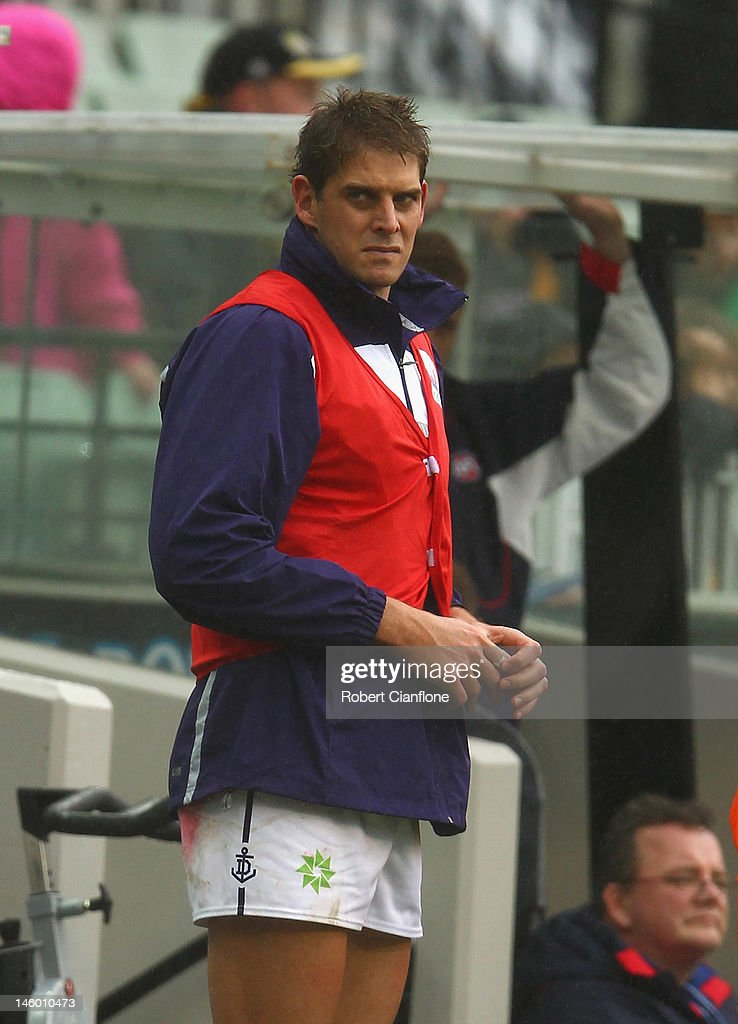 <a gi-track='captionPersonalityLinkClicked' href=/galleries/search?phrase=Aaron+Sandilands&family=editorial&specificpeople=171132 ng-click='$event.stopPropagation()'>Aaron Sandilands</a> of the Dockers looks on from the bench after he was injured during the round 11 AFL match between the Richmond Tigers and the Fremantle Dockers at Melbourne Cricket Ground on June 9, 2012 in Melbourne, Australia.