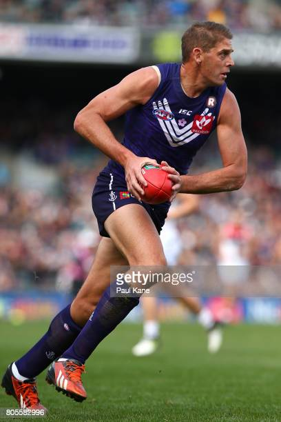 Aaron Sandilands of the Dockers looks to pass the ball during the round 15 AFL match between the Fremantle Dockers and the St Kilda Saints at Domain...