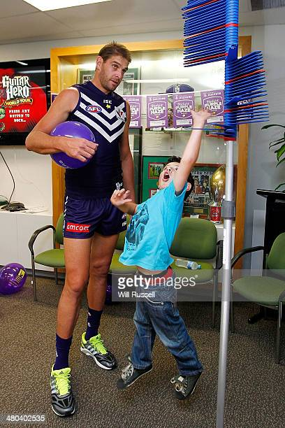 Aaron Sandilands of the Dockers spends time with Starlight children at the Starlight Purple Haze 'Laughternoon' media opportunity at Fremantle Oval...