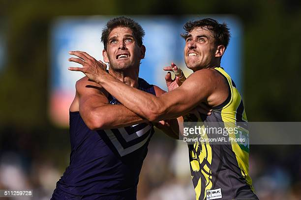 Aaron Sandilands of the Fremantle Dockers contests a ruck with Ben Griffiths of the Richmond Tigers during the 2016 NAB Challenge match between the...