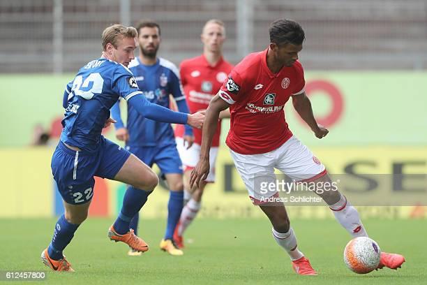 Aaron Seydel of FSV Mainz 05 II challenges Christoph Menz of RW Erfurt during the Third League match between 1FSV Mainz 05 II and RW Erfurt at...