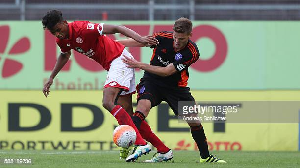 Aaron Seydel of Mainz 05 II challenges Anthony Syhre of VFL Osnabrueck during the Third League match between 1FSV Mainz 05 II and VFL Osnabrueck at...