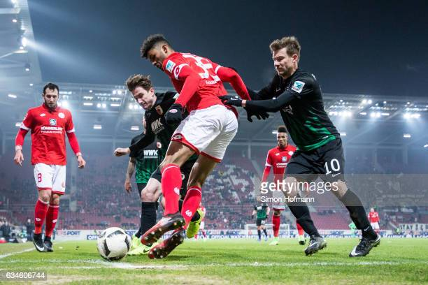 Aaron Seydel of Mainz is challenged by Daniel Baier and Paul Verhaegh of Augsburg during the Bundesliga match between 1 FSV Mainz 05 and FC Augsburg...
