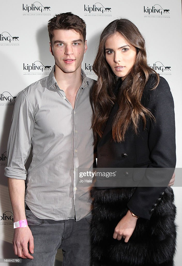 Aaron Sly and Flavia Martins attend the launch of new hangbag collection 'Kipling x Helena Christensen' at Beach Blanket Babylon on April 4, 2013 in London, England.