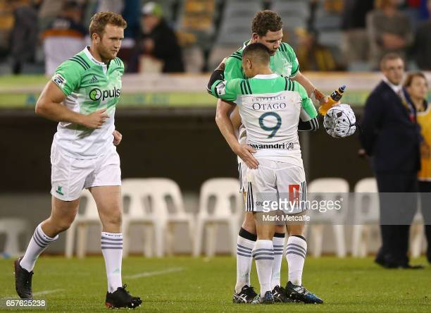 Aaron Smith and Luke Whitelock of the Highlanders celebrate victory in the round five Super Rugby match between the Brumbies and the Highlanders at...