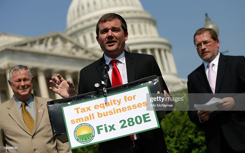 Aaron Smith (C), Executive Director of the National Cannabis Industry Association, with Rep. <a gi-track='captionPersonalityLinkClicked' href=/galleries/search?phrase=Dana+Rohrabacher&family=editorial&specificpeople=2337249 ng-click='$event.stopPropagation()'>Dana Rohrabacher</a> (R-CA) (L) and Americans for Tax Reform President <a gi-track='captionPersonalityLinkClicked' href=/galleries/search?phrase=Grover+Norquist&family=editorial&specificpeople=779501 ng-click='$event.stopPropagation()'>Grover Norquist</a>, speaks during a press conference discussing the taxation of marijuana businesses outside the U.S. Capitol September 12, 2013 in Washington, DC. The National Cannabis Industry Association is seeking tax reform to change the current policy that requires medical marijuana providers to pay taxes based on gross receipts rather than income.