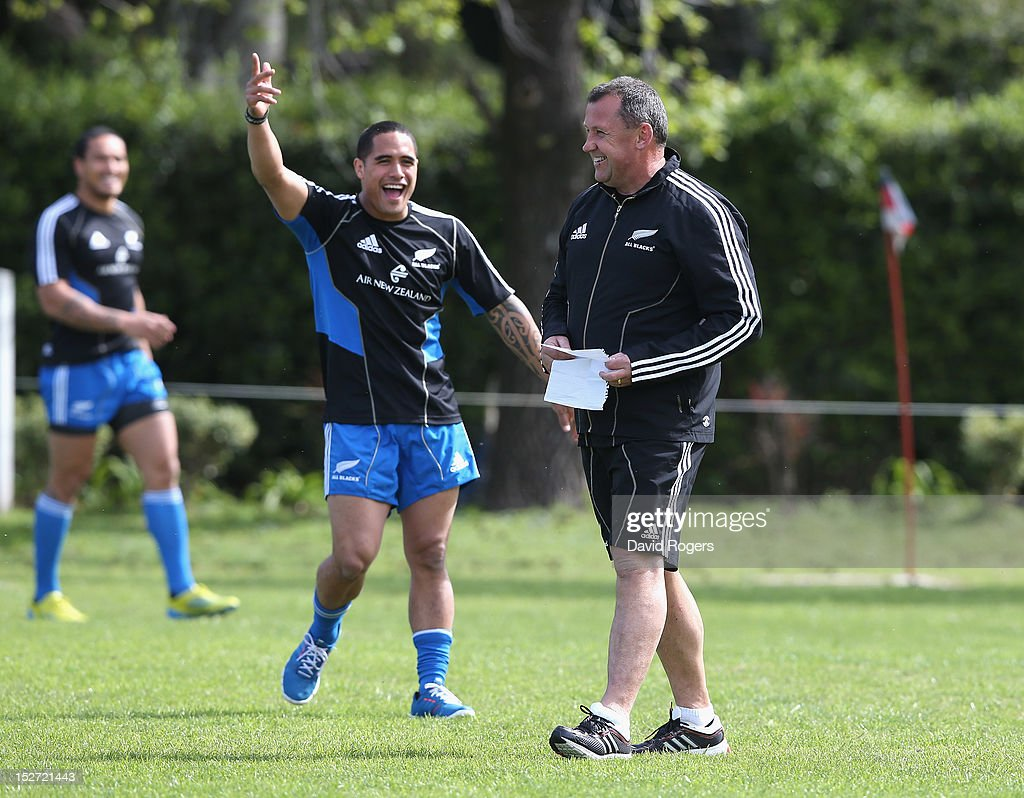 Aaron Smith laughs after accidently hitting Ian Foster, the All Blacks backs coach, with the ball during a New Zealand All Blacks training session at Saint George's College on September 24, 2012 in Buenos Aires, Argentina.