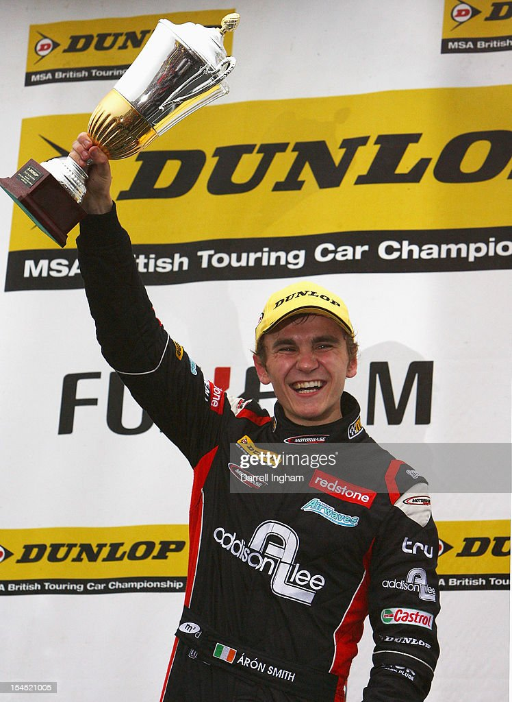 Aaron Smith of Ireland, driver of the #5 Redstone Racing Ford Focus celebrates winning the Dunlop MSA British Touring Car Championship race at the Brands Hatch Circuit on October 21, 2012 near Longfield, United Kingdom.