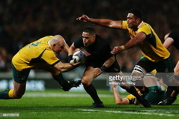 Aaron Smith of New Zealand makes a run against Stephen Moore and Wycliff Palu of Australia during The Rugby Championship Bledisloe Cup match between...