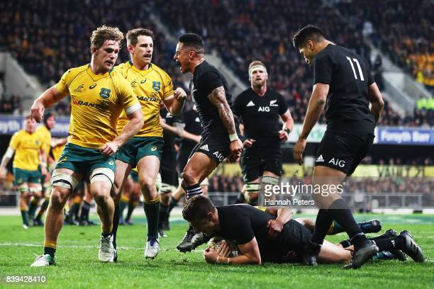 Aaron Smith of the All Blacks celebrates as Beauden Barrett of the All Blacks scores a try during The Rugby Championship Bledisloe Cup match between...