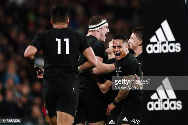 Aaron Smith of the All Blacks celebrates the try from teammate Brodie Retallick during the Rugby Championship match between the New Zealand All...